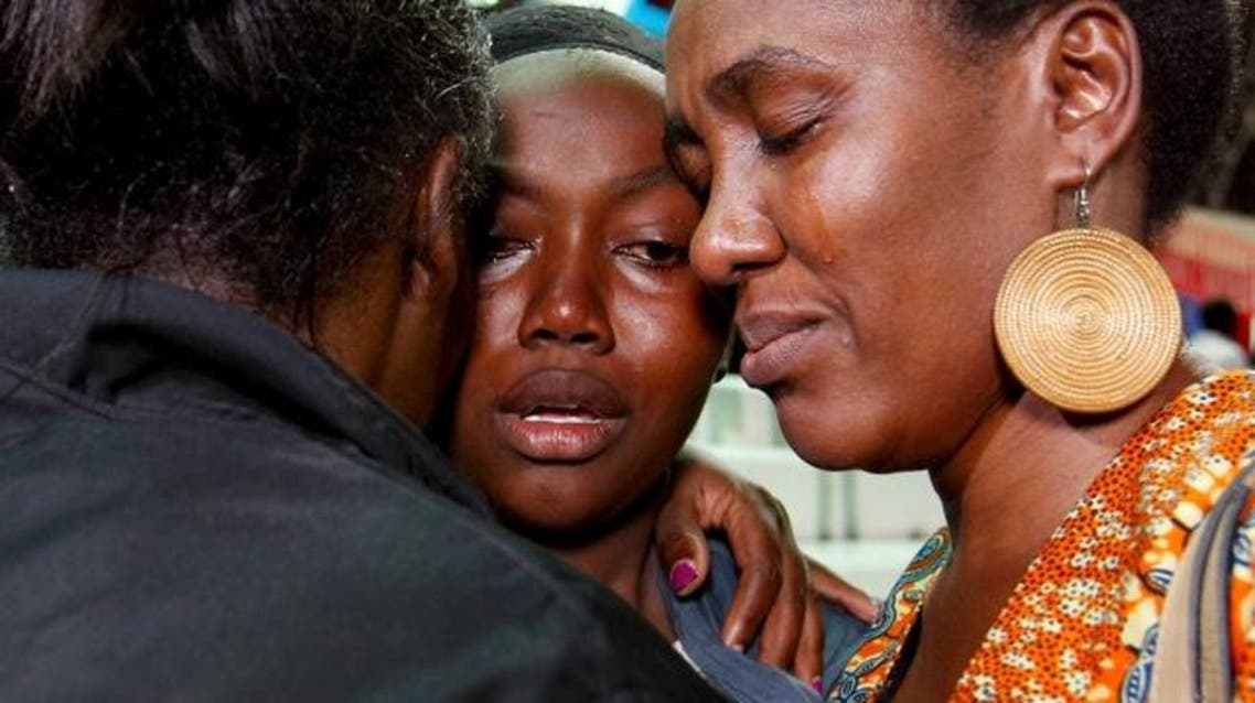 People react after meeting their relative (C) who was rescued from the Garissa University attack at Nyayo stadium in Kenya's capital Nairobi April 4, 2015. (Reuters)
