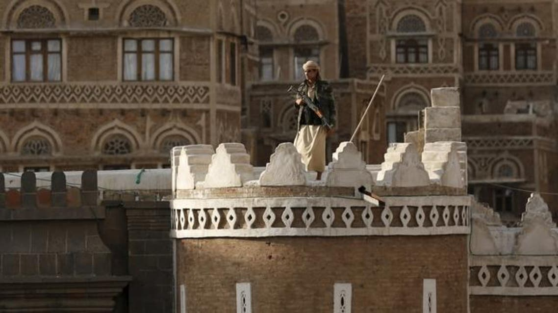A Houthi fighter stands guard as he secures the site of a demonstration by fellow Houthis against the Saudi-led air strikes on Yemen, in Sanaa April 1, 2015. (Reuters)