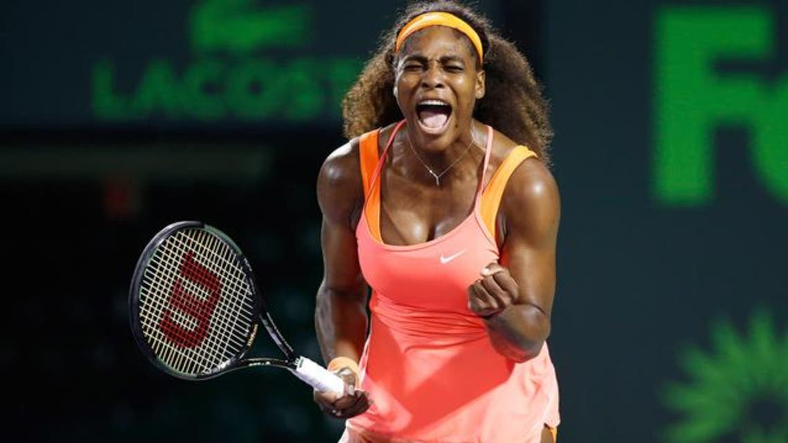 Serena Williams celebrates against Simona Halep (not pictured) during a women's singles semi-final on day eleven of the Miami Open at Crandon Park Tennis Center. (Reuters)