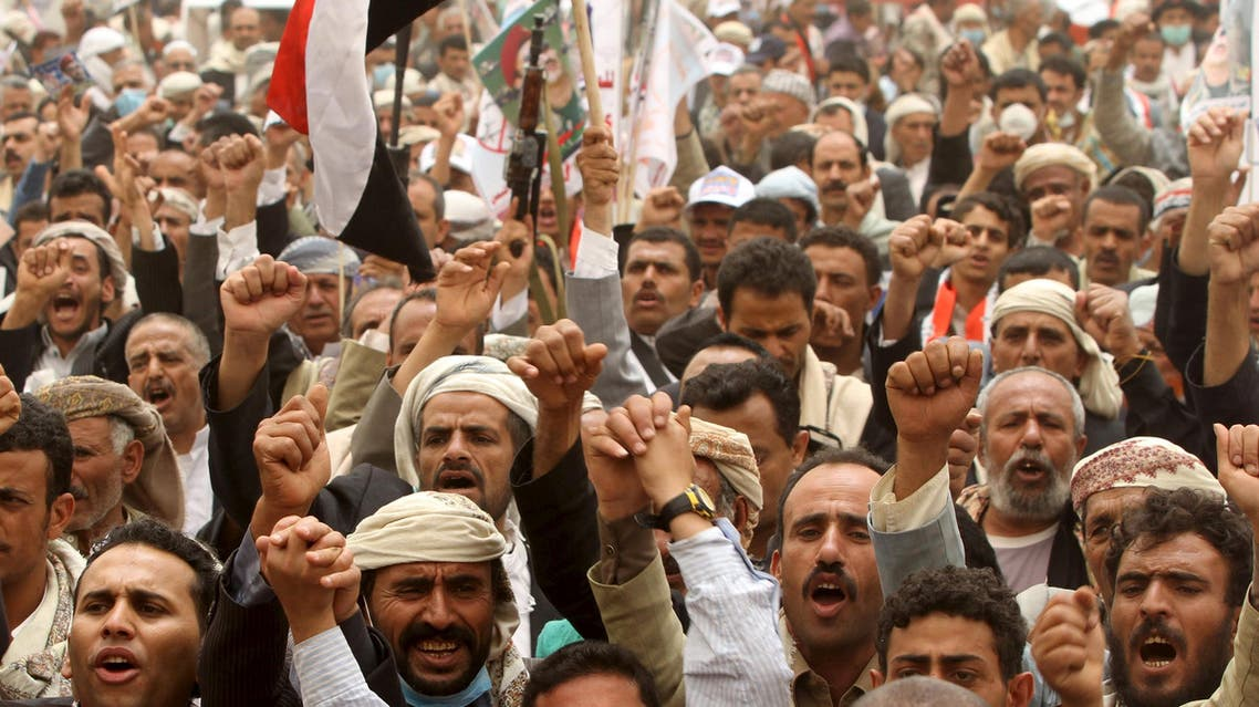 Supporters of Yemen's former President Ali Abdullah Saleh shout slogans during a rally against air strikes in Sanaa. (Reuters)