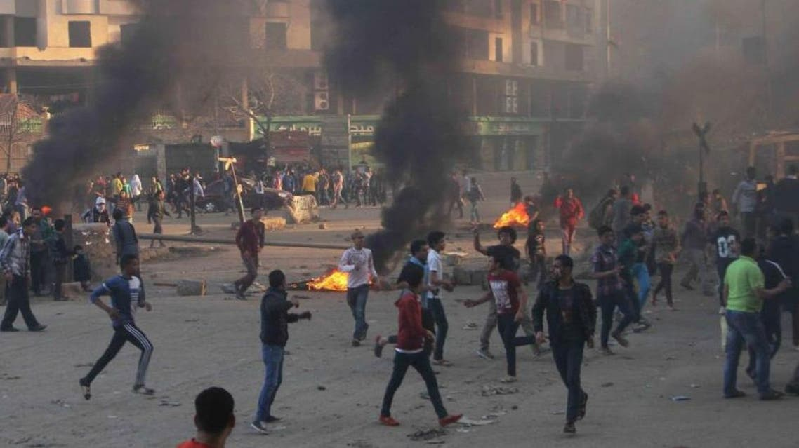 Protesters run during clashes with police in Ain Shams area east of Cairo March 28, 2014. (Reuters)