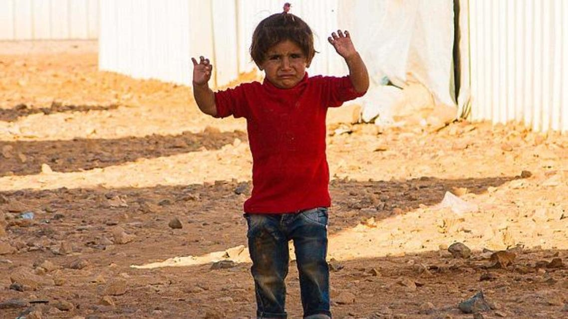 A Red Cross worker has pictured another Syrian girl who became scared and raised her arms to surrender. (Courtesy: Rene Schulthoff)