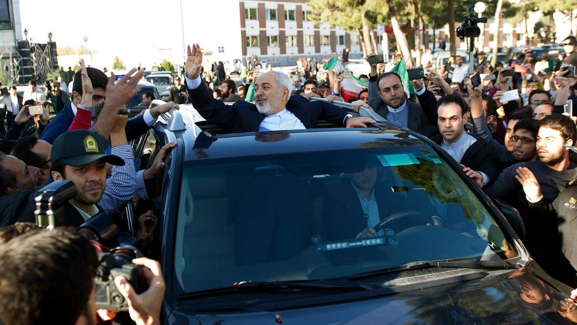 Iranian Foreign Minister Mohammad Javad Zarif (C) greets people as the nuclear negotiating committee arrive at Mehr Abad Airport in Tehran on April 3, 2015. (File: AFP)