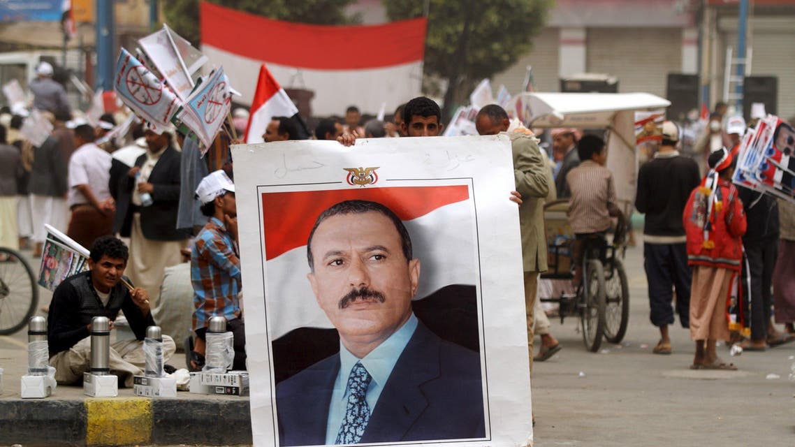 A supporter of Yemen's former president Saleh holds up his portrait during a rally against Saudi-led coalition airstrikes in Sanaa. (Reuters)