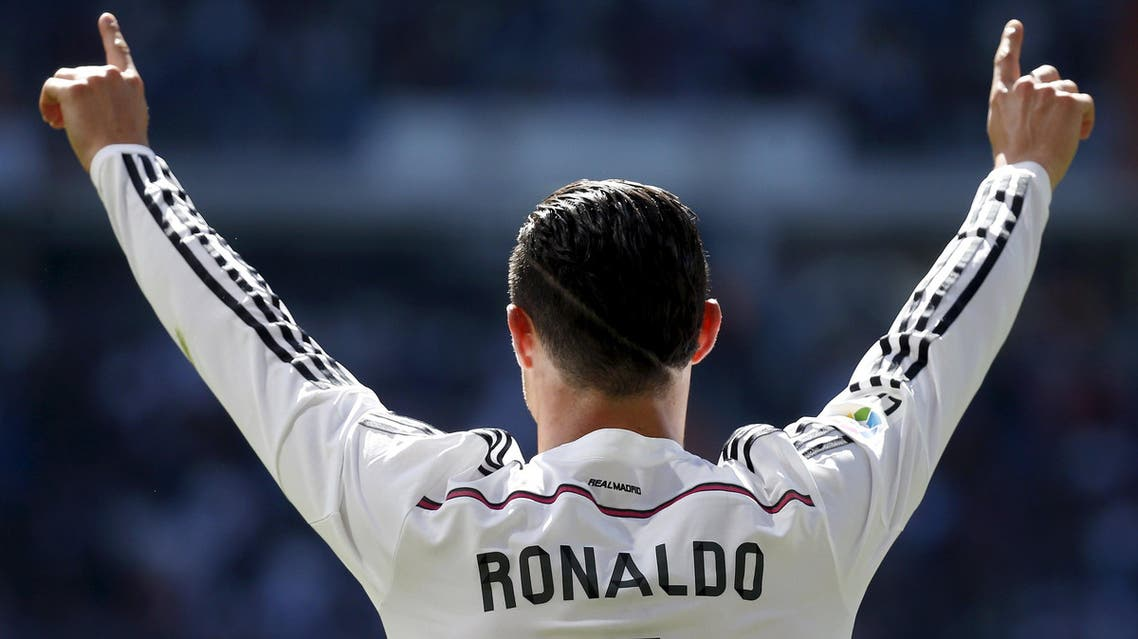 Real Madrid's Cristiano Ronaldo celebrates his goal against Granada during their Spanish first division soccer match at Santiago Bernabeu stadium in Madrid. Reuters