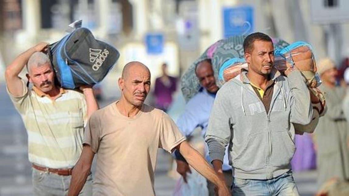 عمال مصريون عائدون من اليمن