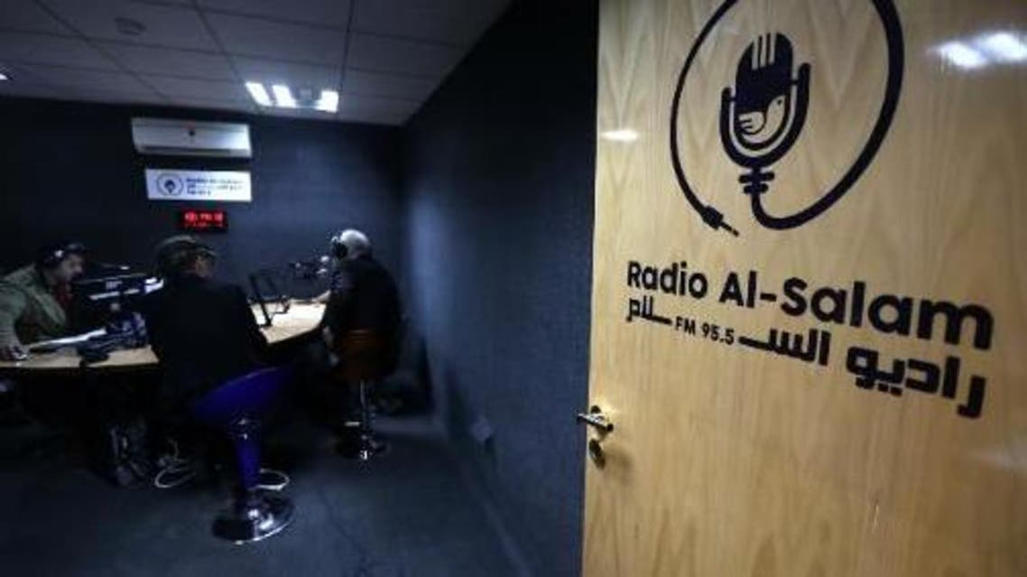 The logo of Radio Al-Salam is seen on the door leading to a broadcast room during the inaugural broadcast on April 5, 2015, in Arbil, the capital of the Kurdish autonomous region in northern Iraq. (AFP)