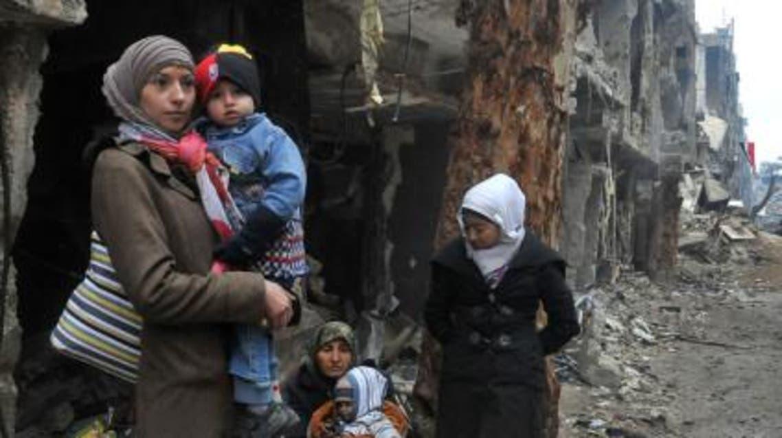 عائلات فلسطينية في مخيم اليرموك