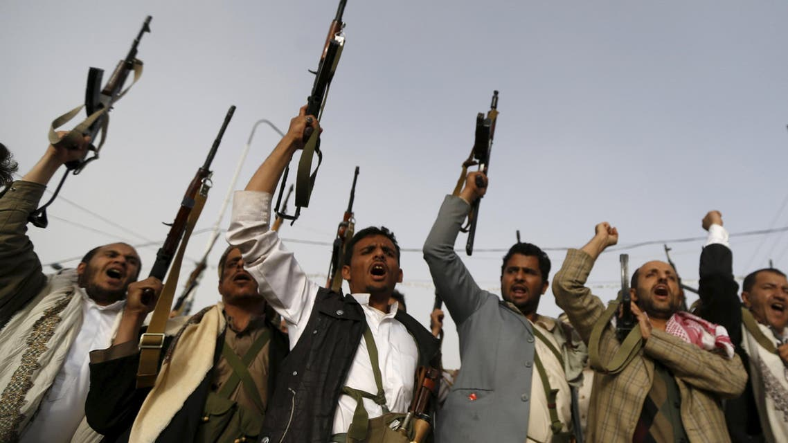 Followers of the Houthi movement raise their rifles as they shout slogans against the Saudi-led air strikes in Sanaa. (Reuters)