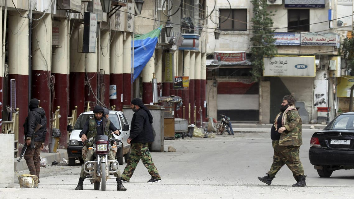 Islamist rebel fighters walk along a street in Idlib city April 1, 2015. (Reuters)