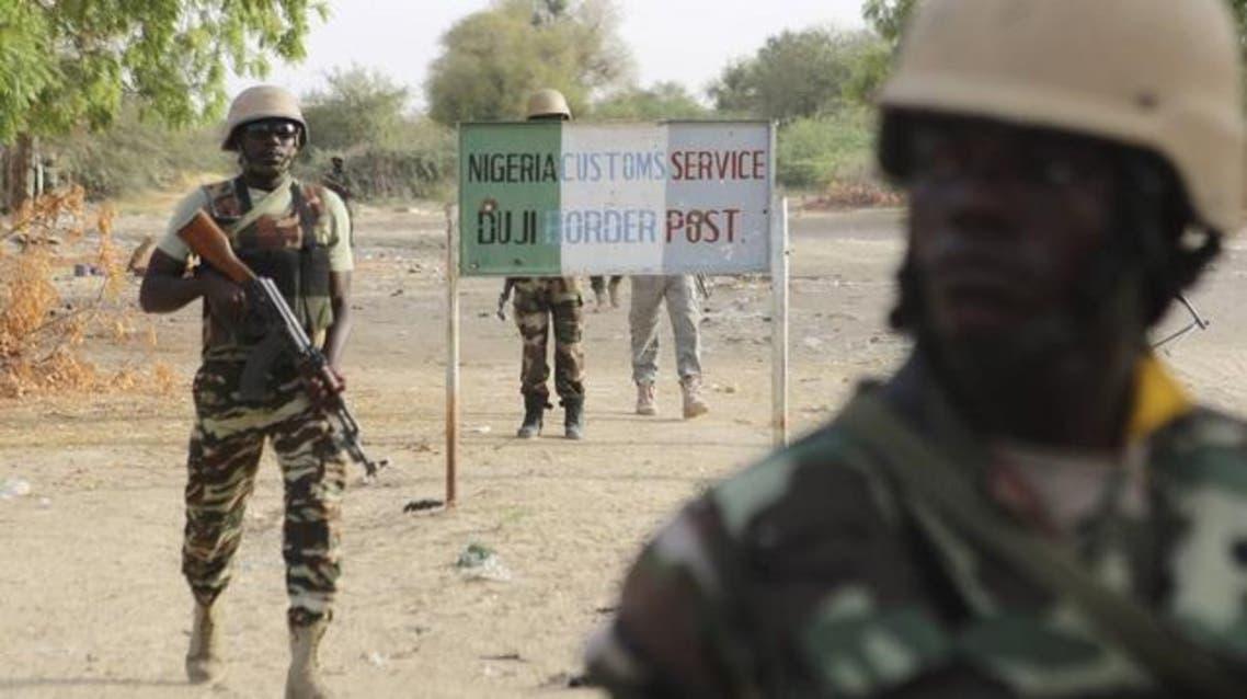 Nigerien soldiers walk past a customs signpost in Duji, Nigeria, March 25, 2015. (File: Reuters)