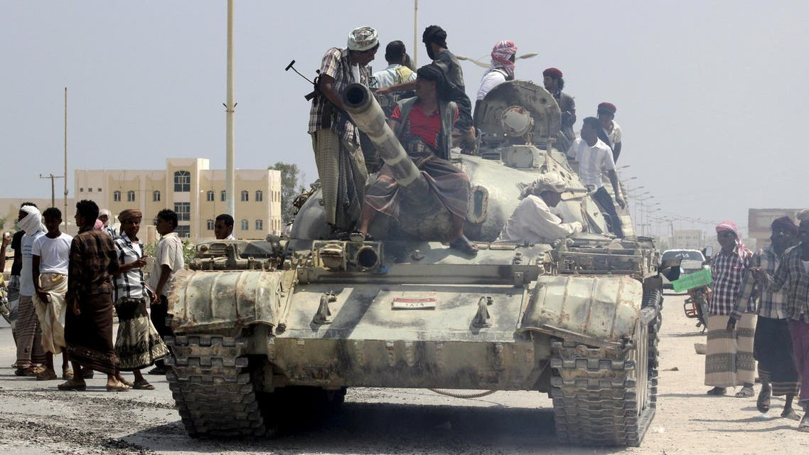 Tribesmen stand on a tank they took from an army base in Shihr city of Yemen's eastern Hadramawt province. (Reuters)
