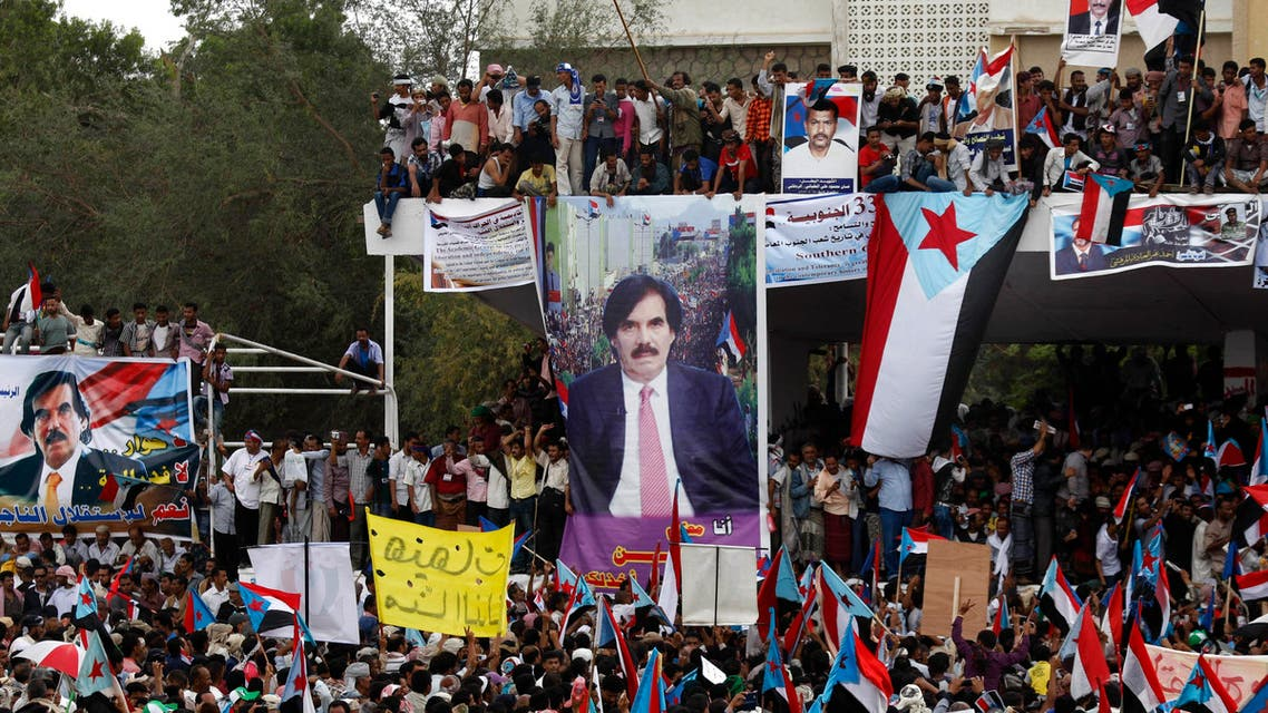 Yemeni supporters of the Southern Separatist Movement hold former South Yemen flags during a rally in Aden, Yemen, Sunday, Jan. 13, 2013. The rally commemorates the anniversary of a civil war that broke out in 1986 in South Yemen with North Yemen. The poster of Ali Salem al-Beidh, former Yemeni Vice President is seen center background. (AP)