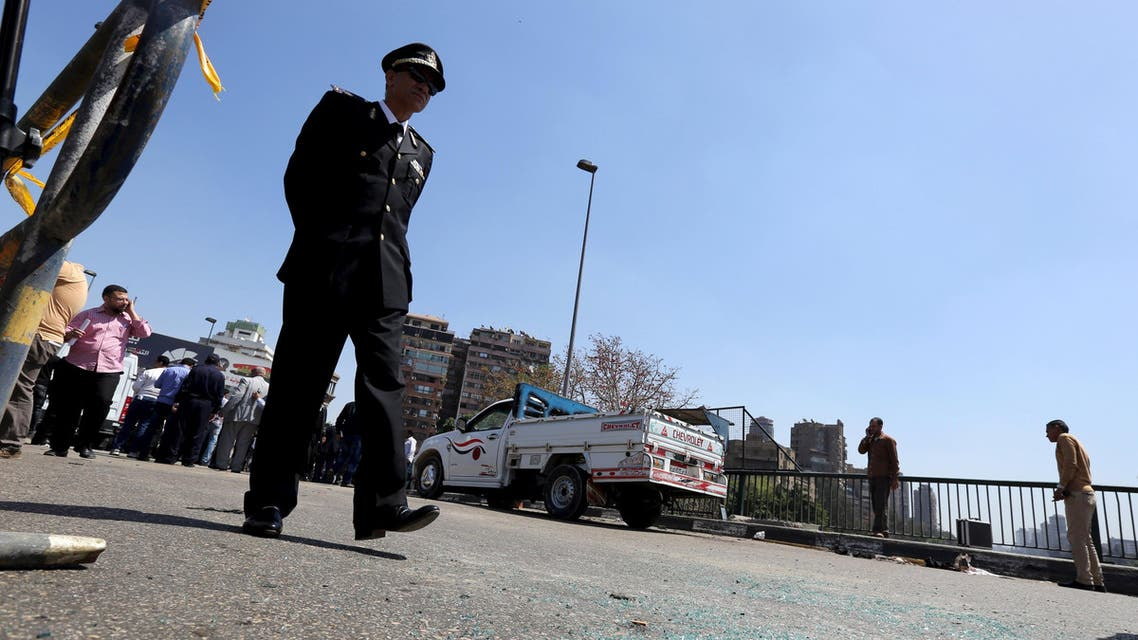 A policeman walks and checks the area after a bomb exploded on a bridge in the Cairo district of Zamalek. Reuters