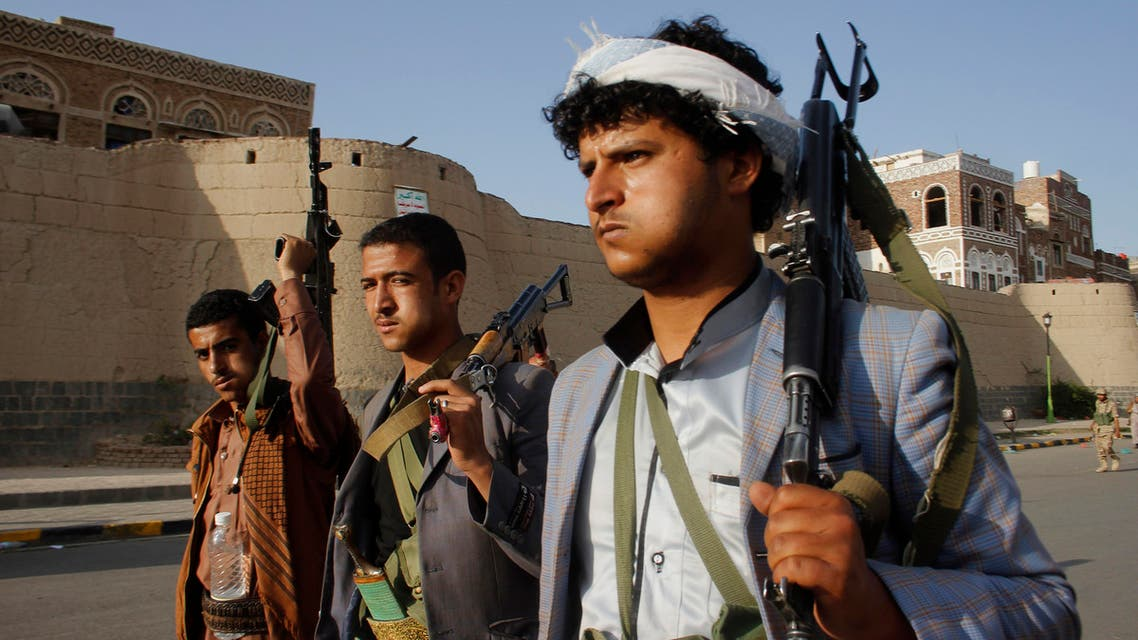 Houthis, carry their weapons as they march to protest against Saudi-led airstrikes, during a rally in Sanaa, Yemen. Saudi-led coalition warplanes bombed Shiite rebel positions in both north and south Yemen early Wednesday, setting off explosions and drawing return fire from anti-aircraft guns. (AP)