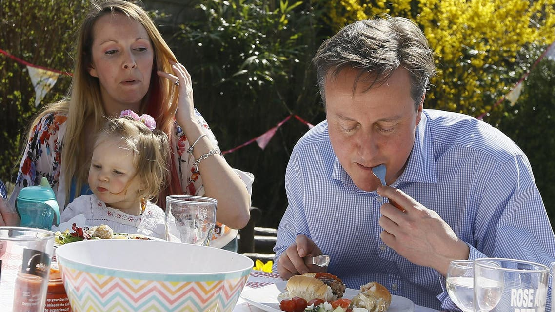 Britain's Prime Minister David Cameron has been skewered in the middle of a tense election campaign -- for eating a hot dog with a knife and fork. AFP