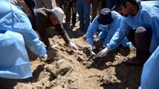 Iraqi teams start exhuming mass grave of soldiers in Tikrit