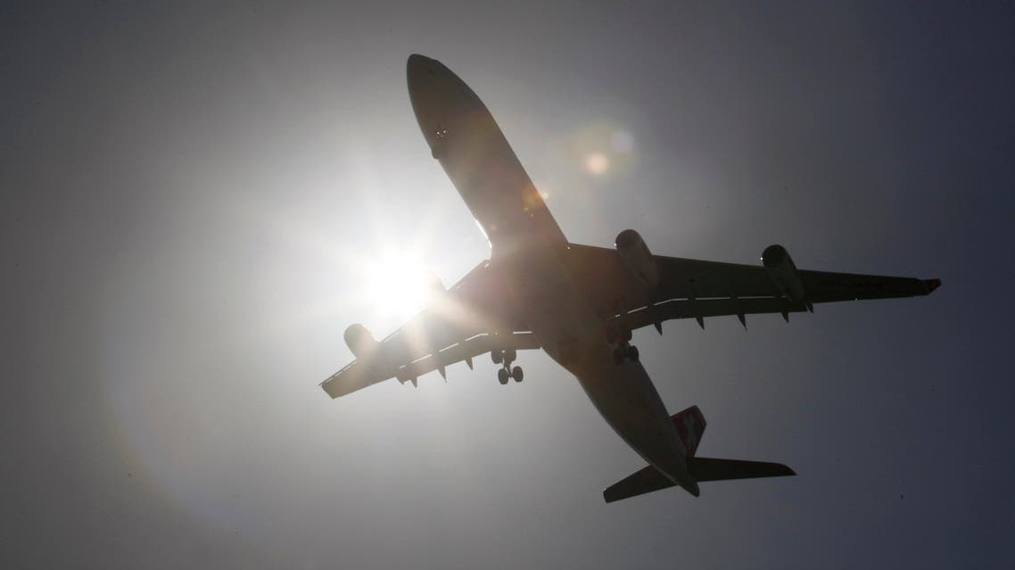 A Swiss International Air Lines Airbus Industrie A340-300 airplane makes its final approach as it lands at Miami International Airport in Miami from Zurich, Switzerland, Monday, May 3, 2010. (AP Photo/Wilfredo Lee)