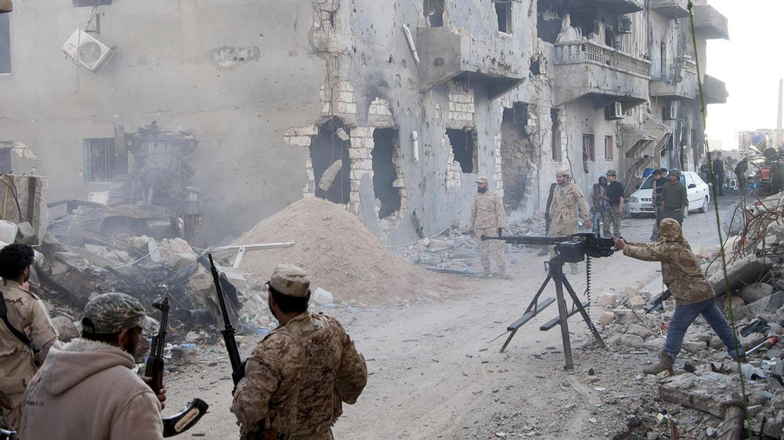 Members of the Libyan pro-government forces, backed by the locals, with weapons are seen during clashes in the streets with Shura Council of Libyan Revolutionaries, an alliance of former anti-Gaddafi rebels who have joined forces with Islamist group Ansar al-