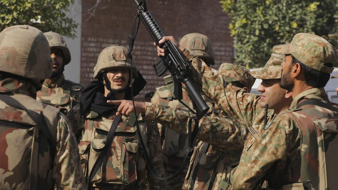 Pakistan army soldiers surround a Shiite mosque attacked by suicide bombers and gunmen in Peshawar, Pakistan, Friday, Feb. 13, 2015. (AP)