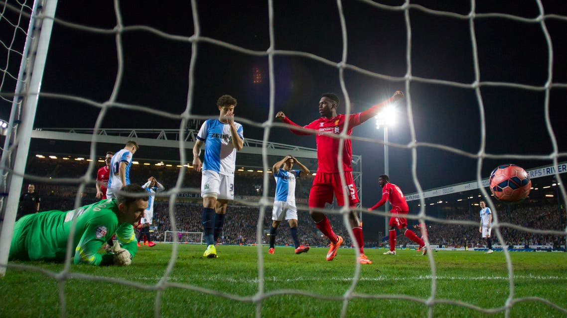 Liverpool's Daniel Sturridge, centre right, celebrates after his teammate Philippe Coutinho, out of frame, scores past Blackburn's goalkeeper Simon Eastwood, bottom left, during the English FA Cup sixth round replay soccer match between Blackburn and Liverpool at Ewood Park Stadium, Blackburn, England, Wednesday, April 8, 2015. (AP Photo/Jon Super)
