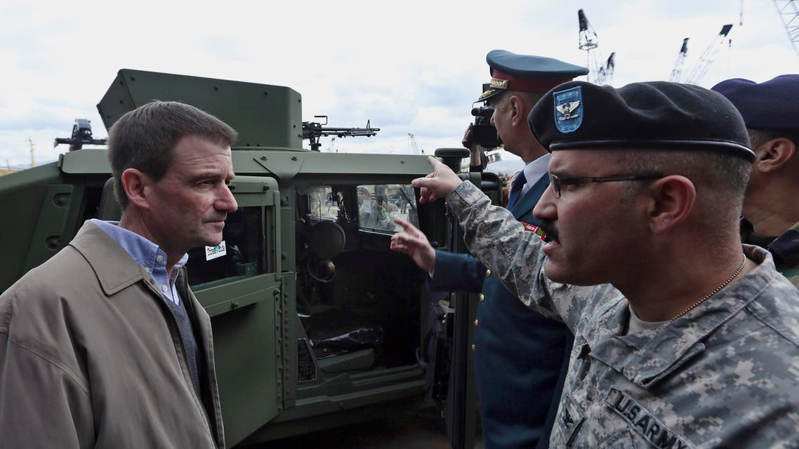 U.S. Ambassador to Lebanon David Hale, left, speaks with a U.S. Army soldier during a handover ceremony of U.S. weapons to the Lebanese army at Beirut's port in Lebanon on Sunday, Feb. 8, 2015. U.S. Ambassador to Lebanon David Hale said $25 million worth of military assistance has arrived in Beirut in the latest American aid to Lebanon's army and that Lebanon has become the 5th largest recipient of U.S. foreign military assistance. (AP Photo/Bilal Hussein)