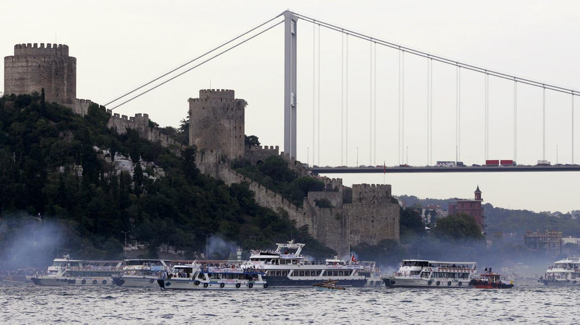 Boats pass by the Ottoman era Rumeli Castle and Fatih Sultan Mehmed brigde as they set sail in Istanbul's Bosporus, Turkey, Sunday, Sept. 26, 2004. (File Photo: AP)