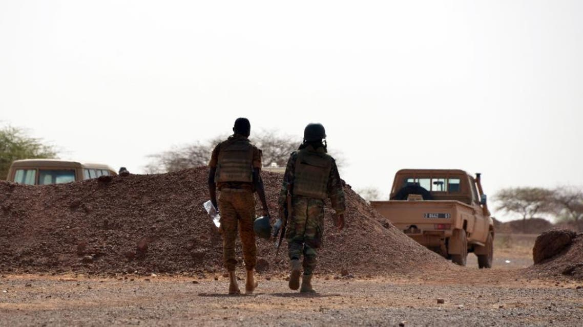 Burkina Faso soldiers patrol near Tambao mine in Tambao, 350 kilometers (220 miles) northeast of the capital, Ouagadougou on April 5, 2015, where five armed men attacked a manganese mine and kidnapped a Romanian mineworker the day before (AFP Photo/Ahmed Ouoba)