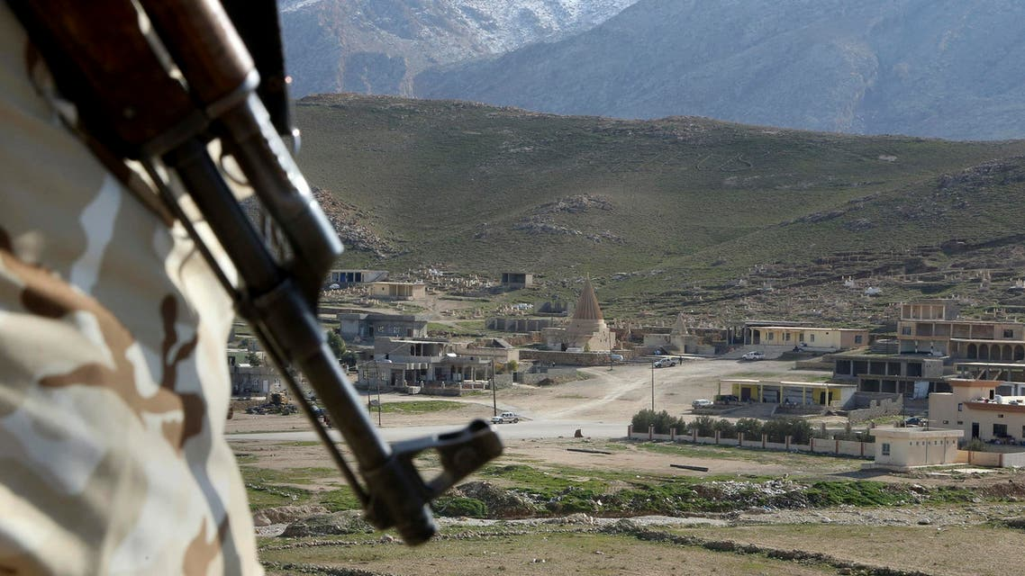 In this Sunday Jan. 11, 2015 file photo, a Yazidi fighter protects the Sharaf al-Deen temple shrine, one of the holiest for the Yazidis, a religious minority whom the Islamic State group considers heretics ripe for slaughter, in Sinjar, northern Iraq. While Islamic State fighters have been forced to retreat from Kobani, the strategic town on Syria's border with Turkey, they appear far from beaten in northern Iraq. Along the Kurds' shifting front lines, it's a tenuous hold. Whichever side triumphs will determine whether Islamic State can use the main highway west to funnel weapons and reinforcements to their retreating comrades in Syria. (AP Photo/Seivan Selim, File)