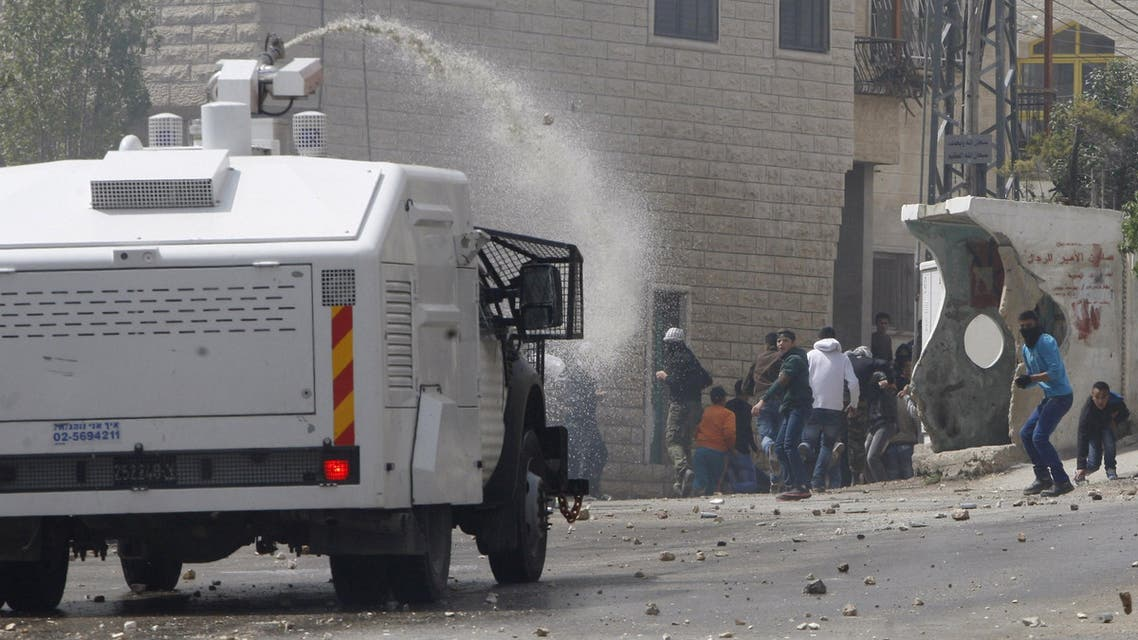 An Israeli police vehicle sprays water during clashes with Palestinians in Beit Omar village near the West Bank city of Hebron April 10, 2015. (Reuters)