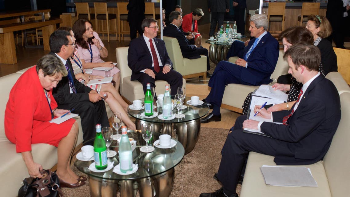 U.S. Secretary of State John Kerry (centre, right) and Cuban Foreign Minister Bruno Rodr�guez (centre, left), flanked by their respective advisers, sit together in Panama City, Panama April 9, 2015 in this handout photo. (Reuters)