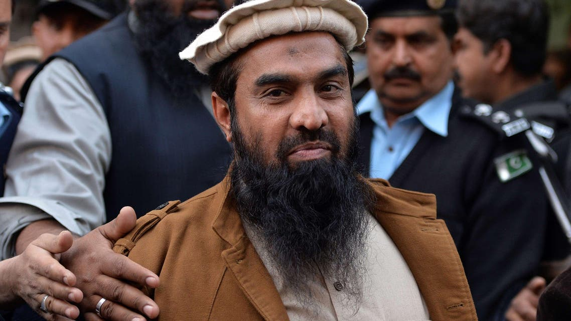 In this photograph taken on January 1, 2015 Pakistani security personnel escort Zaki-ur-Rehman Lakhvi (C), alleged mastermind of the 2008 Mumbai attacks, as he leaves the court after a hearing in Islamabad. (File: AFP)