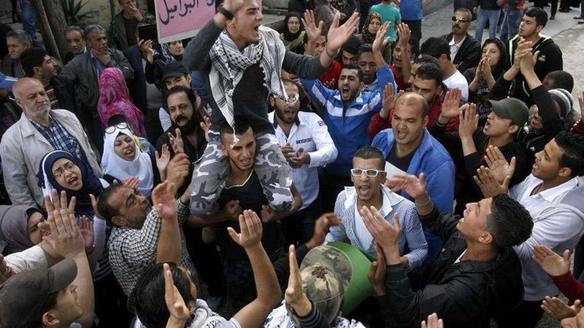 Palestinians rally for Yarmouk refugee camp