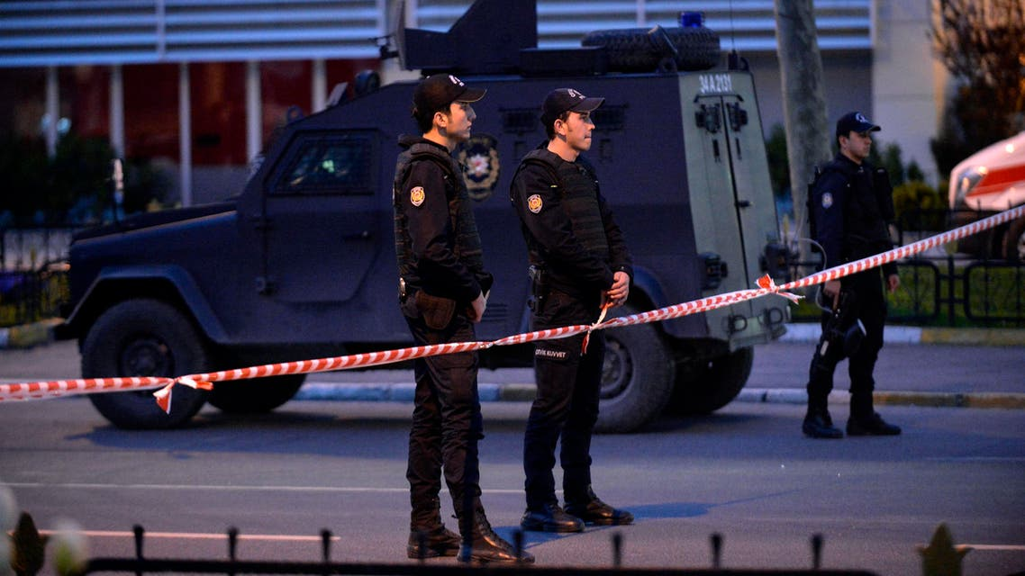 Police officers stand after two leftist militants attacked Istanbul Security headquarters, rear, in Istanbul, Turkey, Wednesday, April 1, 2015. (File Photo: AP)