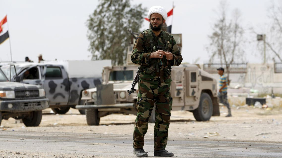 A Shiite cleric from Hashid Shaabi (Popular Mobilisation) forces, allied with Iraqi forces against the Islamic State, holds prayer beads in Tikrit March 28, 2015. (Reuters)