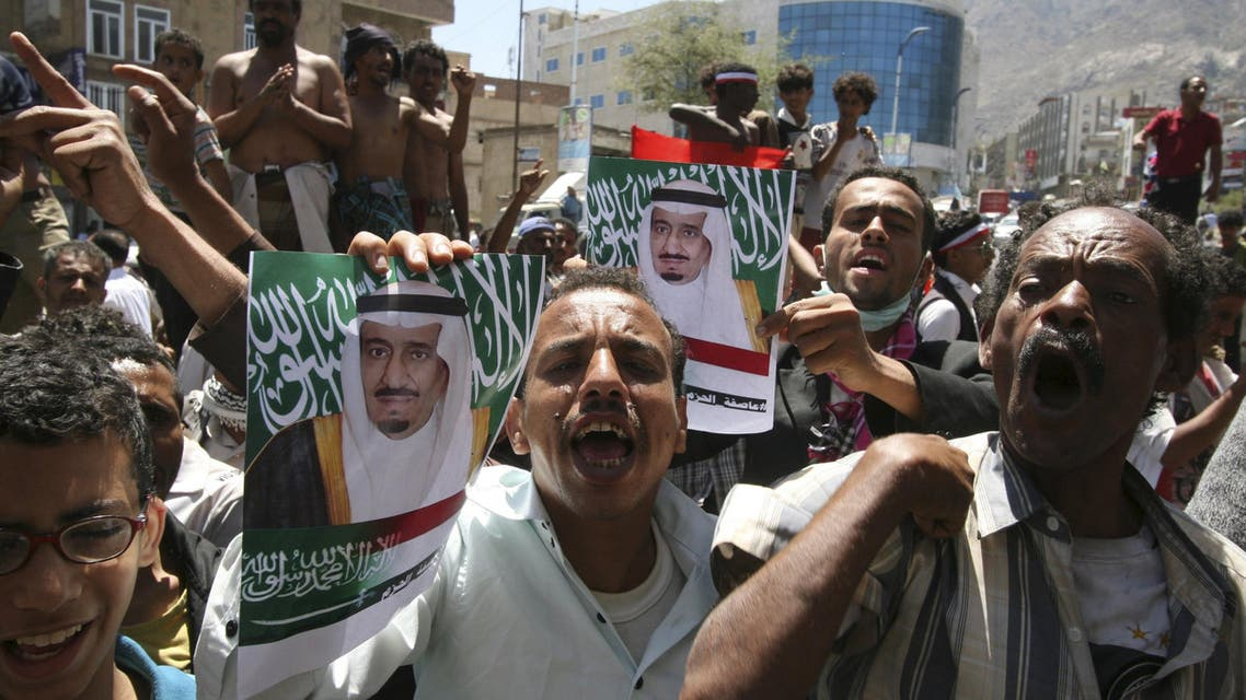 Anti-Houthi protesters hold posters of Saudi King Salman bin Abdulaziz al-Saud during a demonstration to show support for Saudi-led air strikes on Yemen, in the country's southwestern city of Taiz Reuters