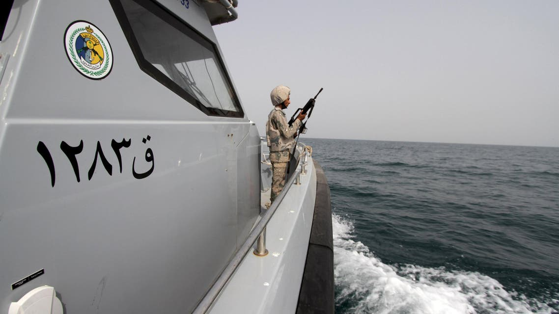 Saudi border guard watches as he stands in boat off coast of Red Sea on Saudi Arabia's maritime border with Yemen, near Jizan Reuters