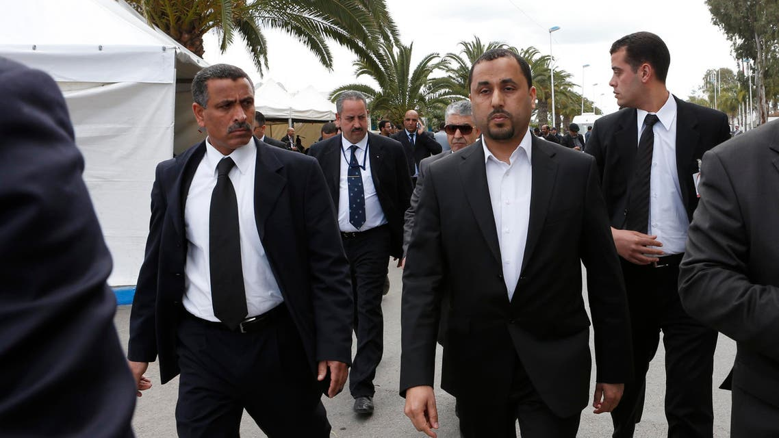 Dr. Saleh Almkhozom, Second Deputy Chairman of the Libyan General National Congress, walks escorted by bodyguards outside the Palais des Congress of Skhirate 30 km south of Rabat, Morocco, Friday, March 20, 2015. (File: AP)