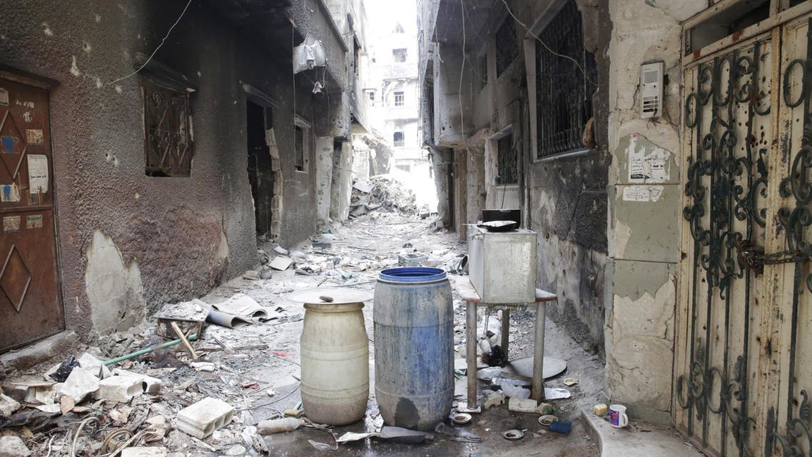 Rubble and heavy damage remain on a deserted street during a government escorted visit to Yarmouk refugee camp in Damascus, Syria, Thursday, April 9, 2015.  (AP)