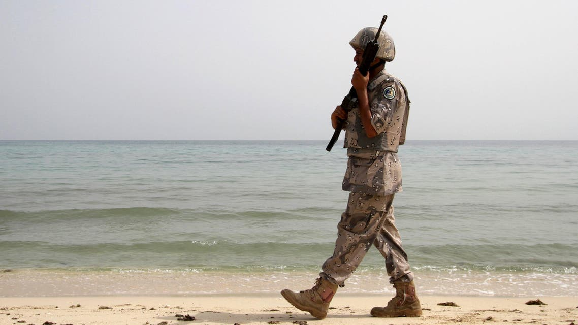 A Saudi border guard patrols near Saudi Arabia's border with Yemen, along beach on Red Sea, near Jizan