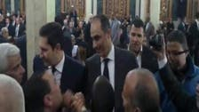 Freed Mubarak sons appear at funeral in downtown Cairo