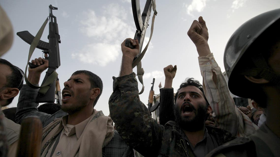 Followers of the Houthi movement raise their rifles as they shout slogans against the Saudi-led coalition air strikes in Sanaa April 10, 2015