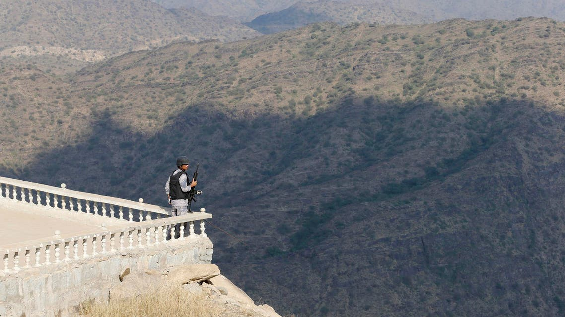 A Saudi soldier stands guard in Jizan on the border with Yemen