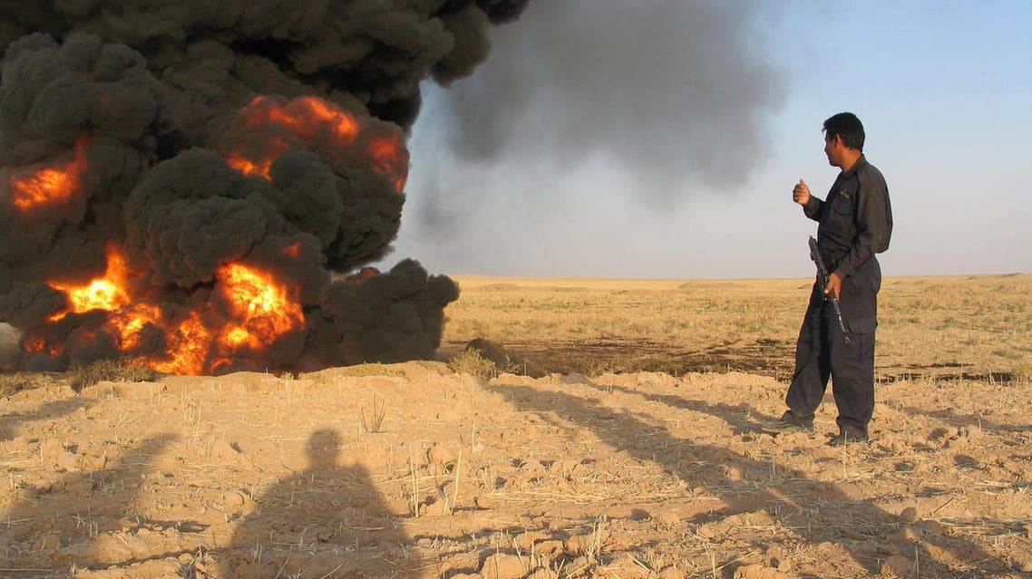 An Iraqi pipeline security guard inspects a damaged oil pipeline caused by a bomb explosion, Thursday, Aug. 4, 2005, in the northern town of Kirkuk, 200 kms. (124 miles) north of Baghdad, Iraq. The pipeline passes by Kirkuk toward the Baiji refineries. ap