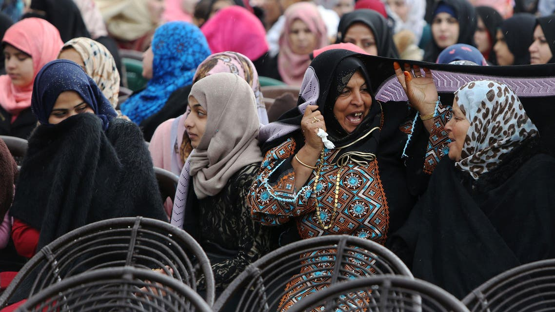 Palestinian women take part in a mass wedding ceremony in Gaza City, on April 11, 2015. (AFP)