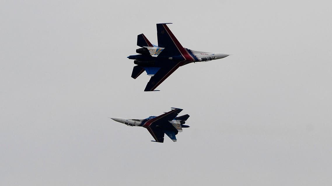 Su-27 fighter jets of the Russian pilot group Russian Knights perform at the the MAKS Air Show in Zhukovsky outside Moscow, Friday, Aug. 30, 2013. (AP Photo)