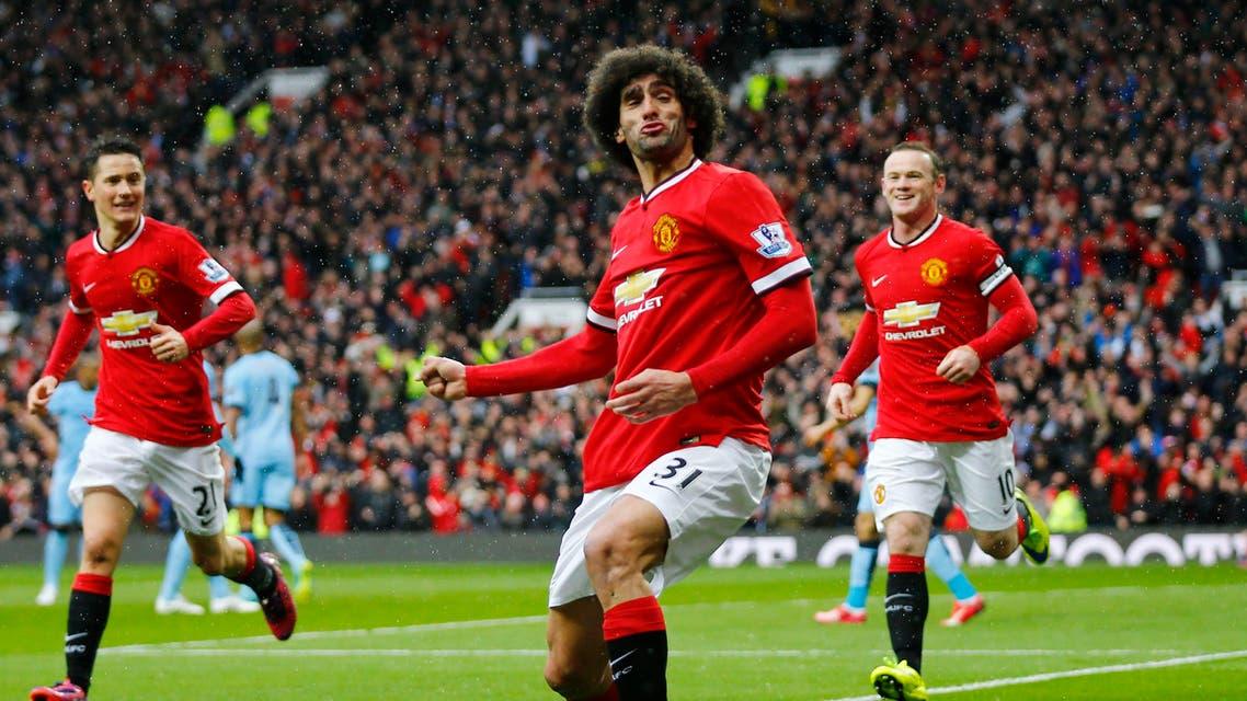 Football: Marouane Fellaini celebrates scoring the second goal for Manchester United. Reuters