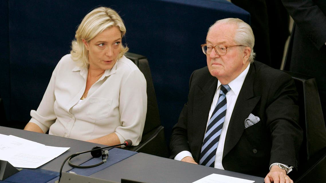 File photo of Jean-Marie Le Pen (R) and his daughter Marine Le Pen sit at the European Parliament, in Strasbourg, eastern France. (File Photo: AP)