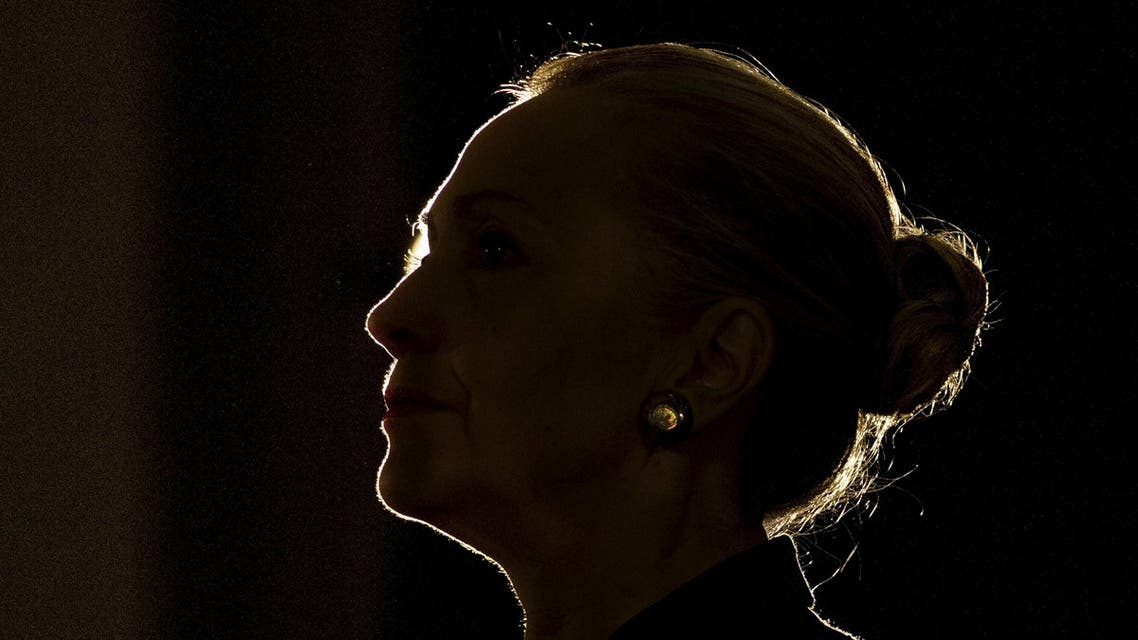 U.S. Secretary of State Hillary Clinton is silhouetted by a stage light as she speaks at the University of the Western Cape about the U.S.-South Africa partnership, in Cape Town in this August 8, 2012 file photo. Hillary Clinton announced her second run for the presidency on April 12, 2015, starting her campaign as the Democrats' best hope of fending off a crowded field of lesser-known Republican rivals and retaining the White House. REUTERS/Jacquelyn Martin/Pool/Files FROM THE FILES PACKAGE 'Hillary Clinton Announces Presidential Bid' SEARCH 'Hillary Clinton Announces Presidential Bid' FOR ALL 20 IMAGES