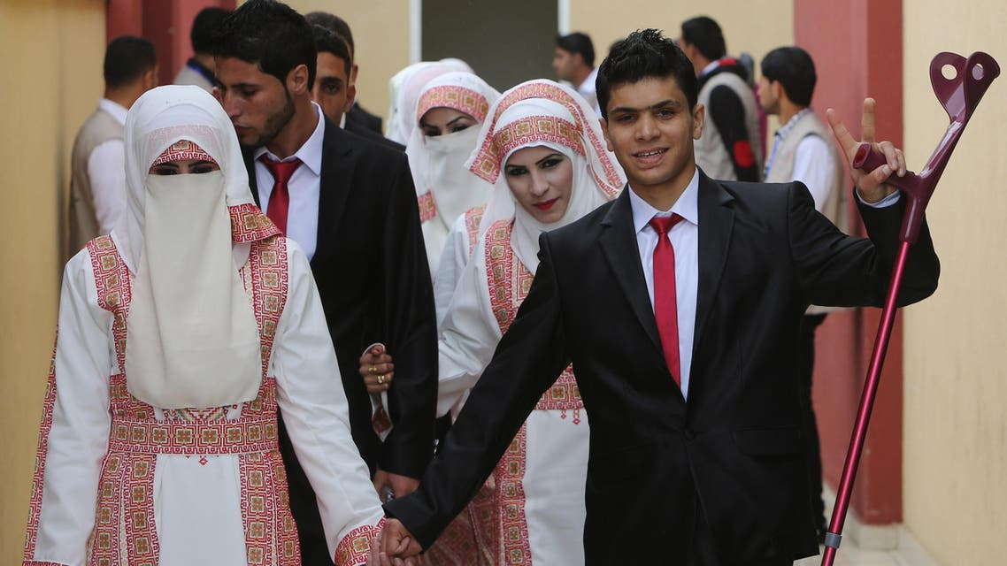 Palestinian bride Marwa Mousa and her groom Ahmed Abu Salama take part in a mass wedding ceremony in Gaza City, on April 11, 2015. (AFP)